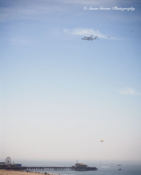 space shuttle and 747 in flight over Santa Monica pier