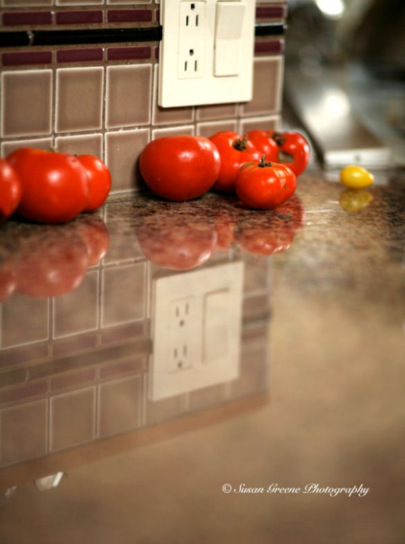 tomatoes reflected in counter top