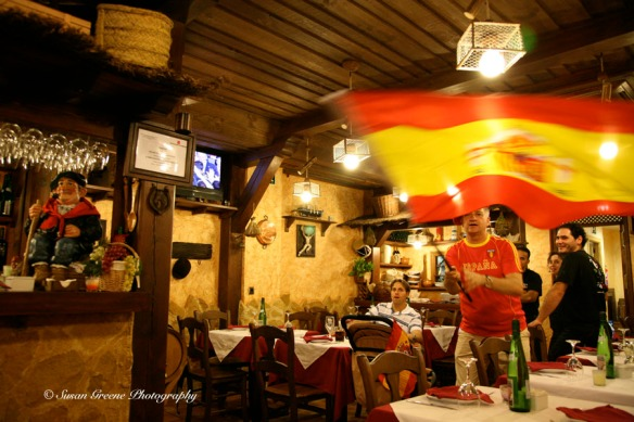 man waving Spanish flag